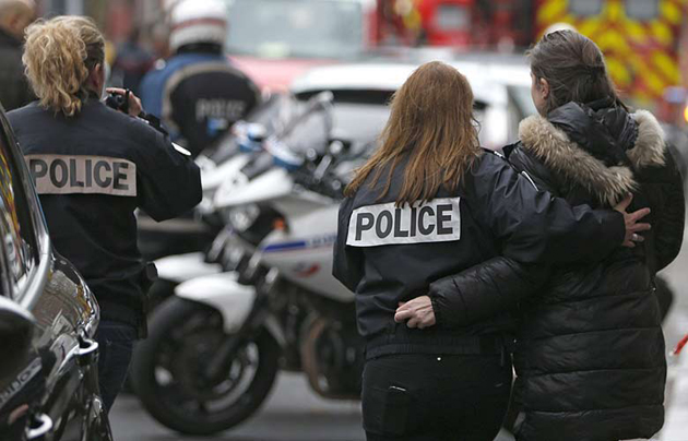 Police outside the Charlie Hebdo office, after the attack. / Reuters.,police Hebdo