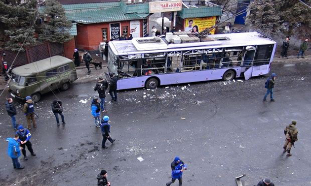 The bus attacked in Donetsk. / The Guardian,Donetsk bus stop explosion