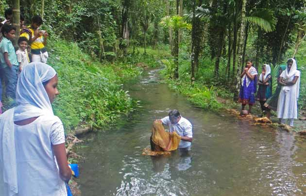 Baptism of a convert to Christianity at an undisclosed village in India. / Christian Aid Mission,India, baptism, persecuted, rural
