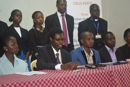 National director and students during the press conference. / Focus Kenya