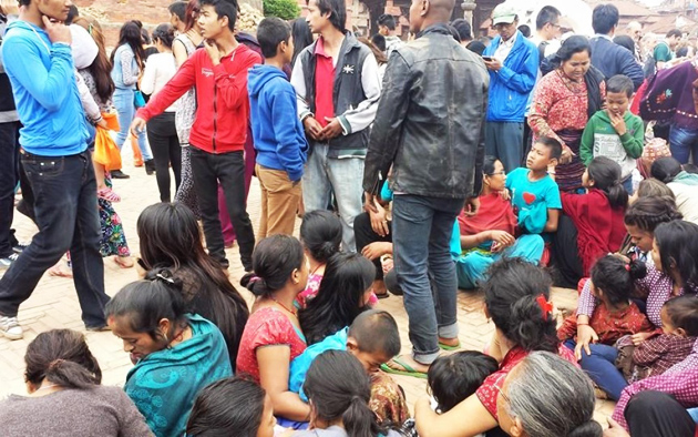 Nepalese citizens gathering on the streets after Saturdays' earthquake. / WV,