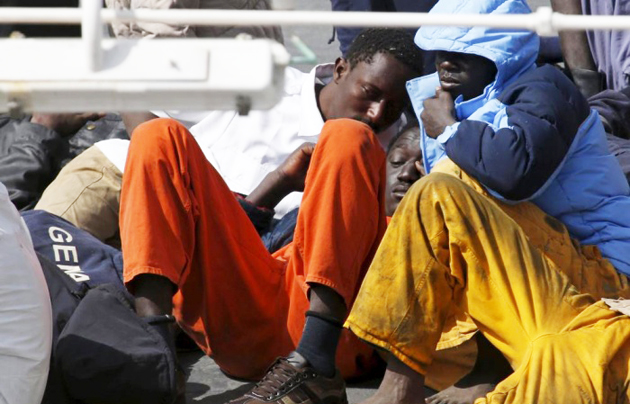 Migrants lie on the deck of the Italian coastguard ship Bruno Gregoretti in Senglea, Malta. / Reuters,mediterraean