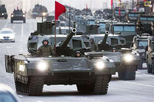 Two Russian T-14 Armata tanks make their way to Red Square during a rehearsal for the Victory Day military parade in Moscow, in May 2015. / AP,Russian tanks, Putin