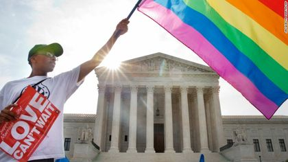 A man wavves he gay flag in Whasington / Reuters