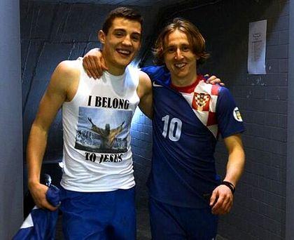 Kovacic with Modric, wearing the I belong to Jesus shirt.