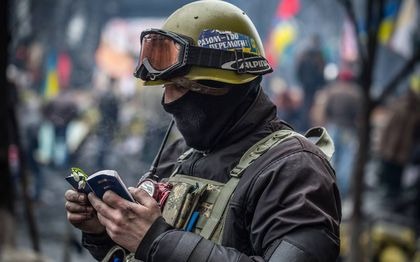 A soldier reads the Bible in Ukraine