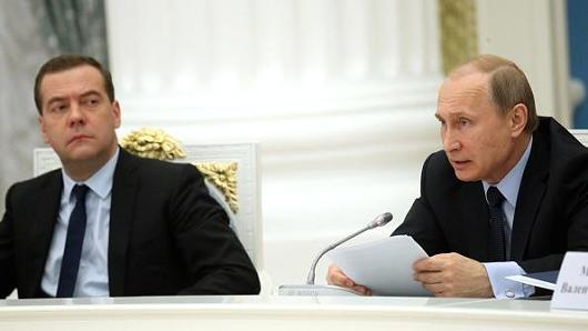 Russian Head of Government Dmitriy Medvedev and president Vladimir Putin. / CNBC,Medvedev, putin, russia, evangelicals, relgious freedom
