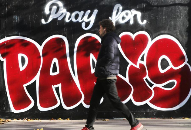 A message on a wall asks people to pray for Paris. / Reuters.,pray for paris, graffiti, wall