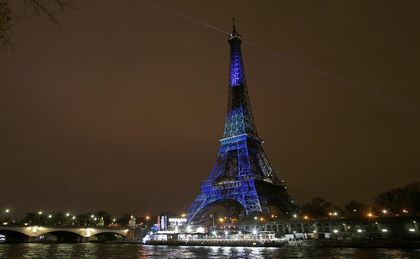 Eiffel Tower in blue and green because of COP21 / Reuters
