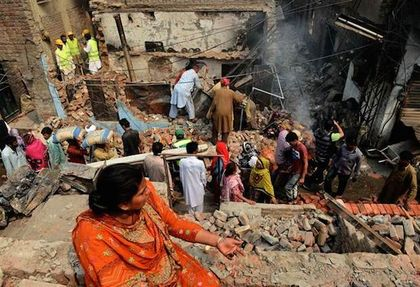 In Pakistan (6 th on the List), a Christian woman looks at her destroyed house.