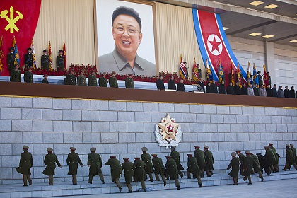 Senior military members approach an area where new North Korean leader Kim Jong Un and other military and political leaders stand, 16 February 2012. / David Guttenfelder.