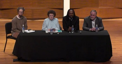 The speakers, during the conference at Calvin College.