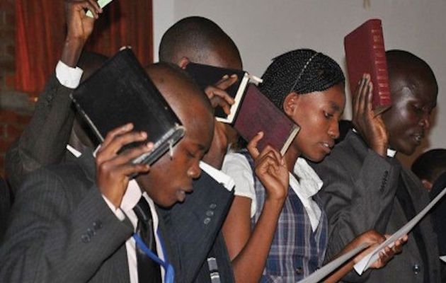 Uganda Christians during a religious debate,