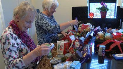Volunteers preparing boxes.
