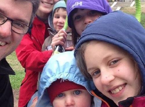 A picture of the Bodnariu family. / Cristian Ionescu,bondariu, family, petition, baby