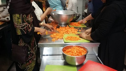Preparing food in the kitchen. / Helping Hands