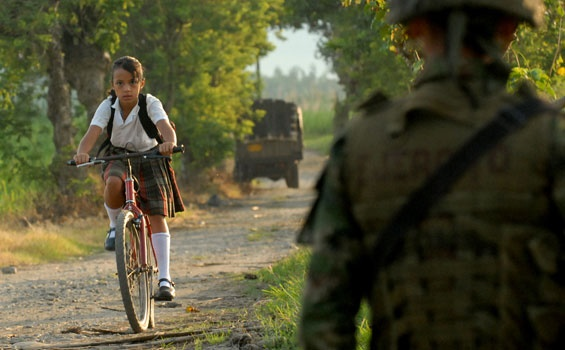 A student goes through a military control in Colombia. / Agencies