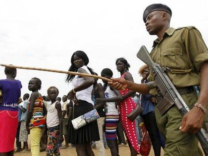 South Sudanese armed forces at the entrance of a church/ Reuters