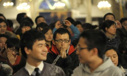 Young Chinese attend church services regularly