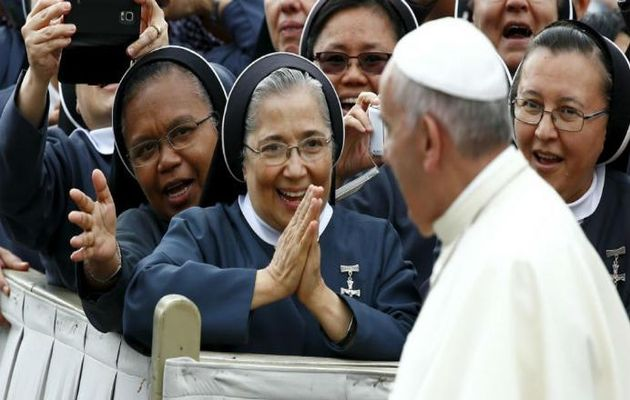Pope Francis with a group of nuns,