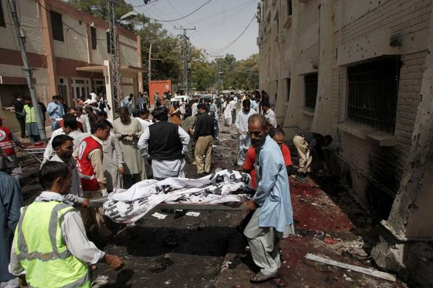 Hospital employees and volunteers at the attack scene/ Reuters,