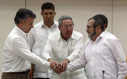 Santos and Timochenko after the signing of the agreement in Havana.