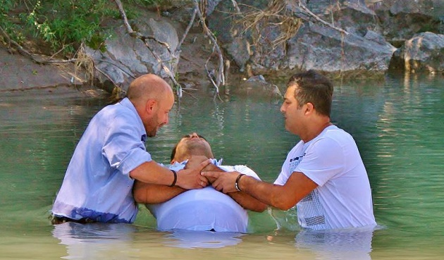 An asylum seeker gets baptised with a Pentecostal church in Weishaus (Germany). / All-in.de,baptism, germany, pentecostal, evangelical