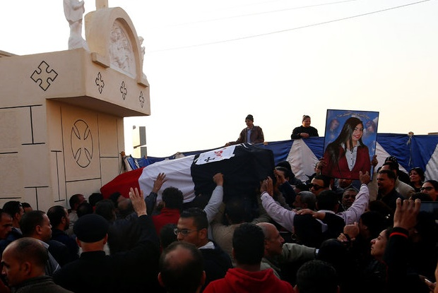 The body of a Christian women killed in the bombing is carried to a cemetery in Cairo on Monday, 12 December. / Reuters,