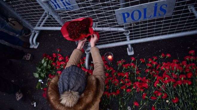 Flowers are laid outside the nightclub, a glitzy venue in the cosmopolitan Ortakoy district. / AFP,