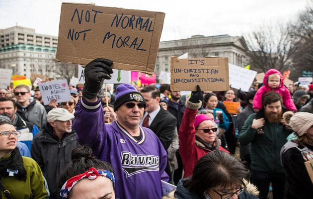 Demonstrators gather near the White House to protest President Donald Trump's travel ban on seven Muslim countries on Sunday in Washington. / Getty,