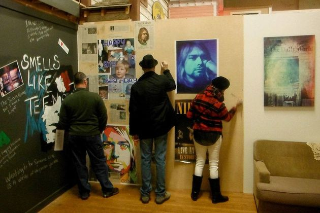Visitors to the Aberdeen Museum of History write a personal greeting for what would have been Cobain's 50th birthday. ,