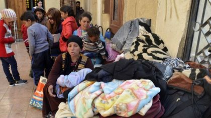 Persecuted Christians arrive to the shelter. / Egyptianstreets.com