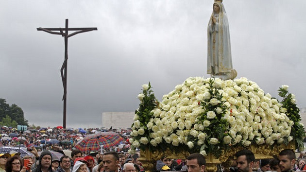 A procession in Fatima, Portugal. / AFP,