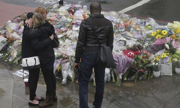 People pay tribute to the victims of Saturday's attack.,