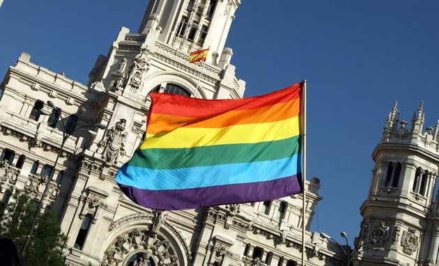 A rainbow flag in front of the Madrid City Hall.,