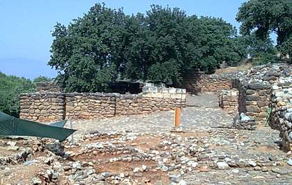 A slope with the remains of stone walls at Tel Dan, the place where Lawrence Mykytiuk found a reference to King David.