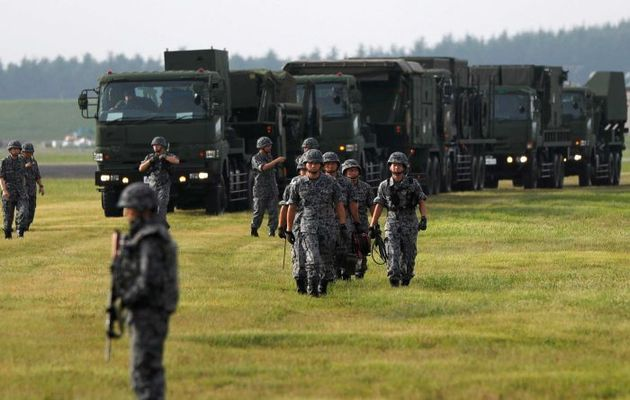 Japanese soldiers take part in a drill in response to a recent missile launch by North Korea. / Reuters,