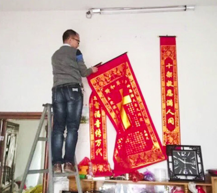 A man take off Christian banderoles. / Lvv2.com, South China Morning Post