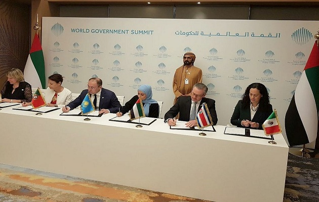 The representatives of the member countries signing the agreement . / The United Arab Emirates Press.,