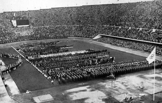 Japan and Germany were in the opening ceremony of the Helsinki Olympic Games in  1952. / Wikimedia Commons.,