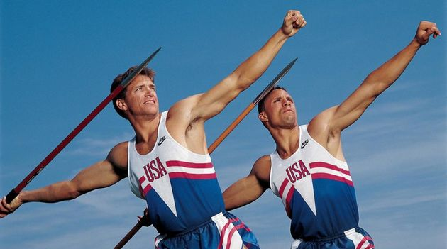 Dan O'Brien and Dave Johnson pose with javelins during Barcelona 1992. / SI.,