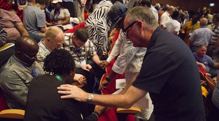 Prayer time during the first day of the conference. / Fb Gafcon