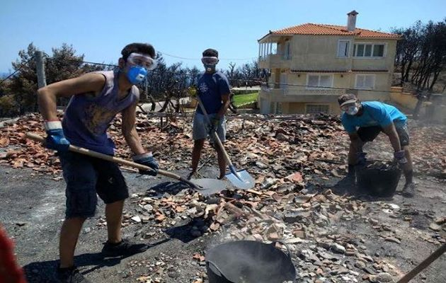 A team of young people from a local church nearby the fired area of Mati, Attica, went 10 times to help people with their burnt down properties. / Nikos Stamoulis.,