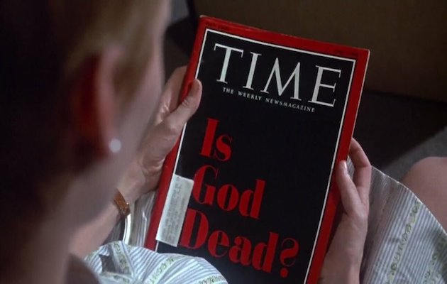Rosemary looks at the front page of Time magazine. ,