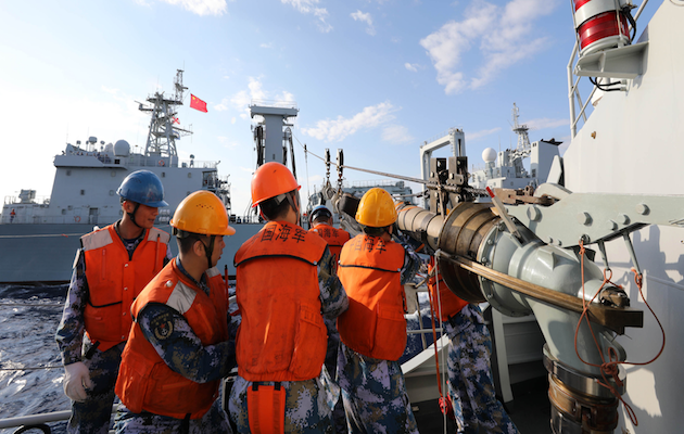Chinese marines on manoeuvres in the Sea of China. / Zhou Qiqing, China military.,