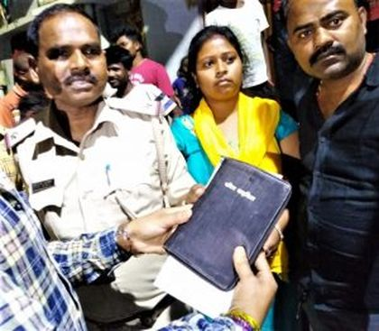 Villagers hand Bible to police in Lalpur as evidence against Christians in Ranchi, Jharkhand state, India. / Morning Star News.
