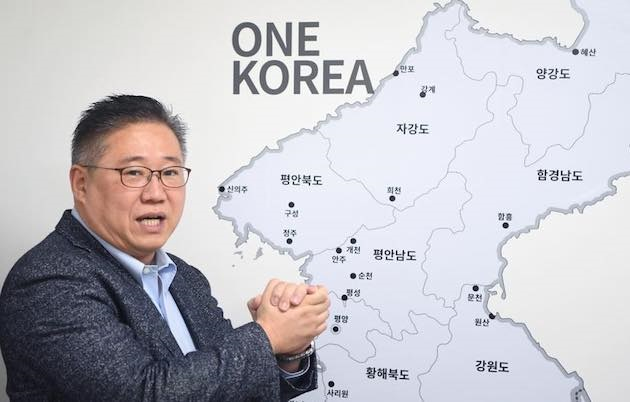 Christian worker Kenneth Bae, with a map showing an unified Korea. / Facebook Kenneth Bae,