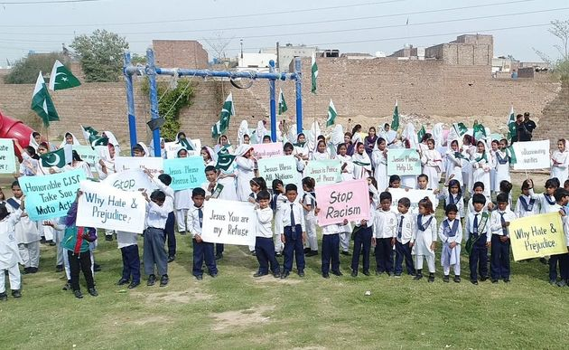 Children and school staff protest outside of New Covenant School. / Iftikhar Indryas.,
