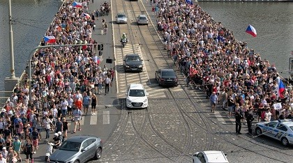 A constant stream of people crosses a bridge in Prague to access the site of the demonstration.