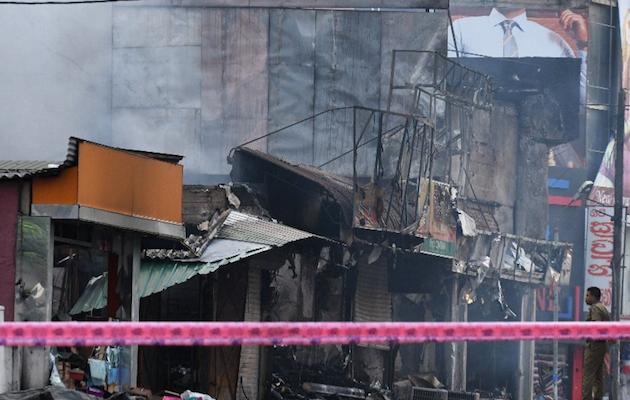 Muslim businesses burnt . /  Twitter @nceasl,